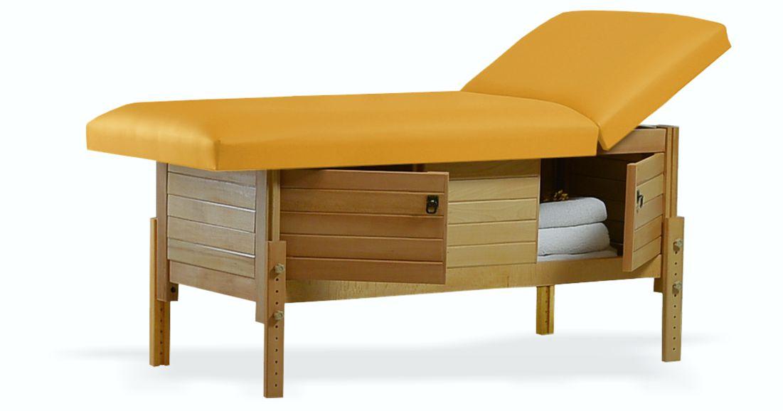 Masă de masaj staționară, model Aisha, de la BIOS, pernă două secțiuni, tapițerie galben-piersică, finisaj lemn natur, spațiu de depozitare cu două usi batante.